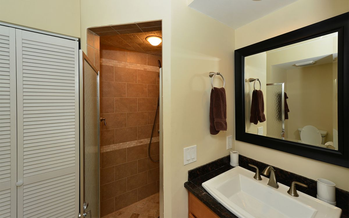 Bathroom with Shower Stall in Hallway