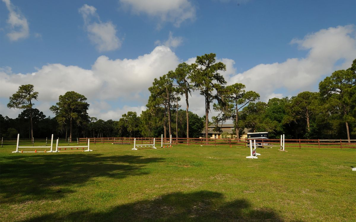 Schooling Ring with Jumps Facing Country House